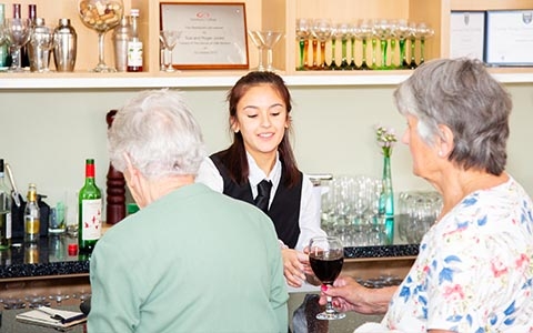 Hospitality student serving customers